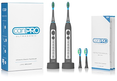 Two gray electric toothbrushes. CariPRO Ultrasonic Toothbrush. An honest review.